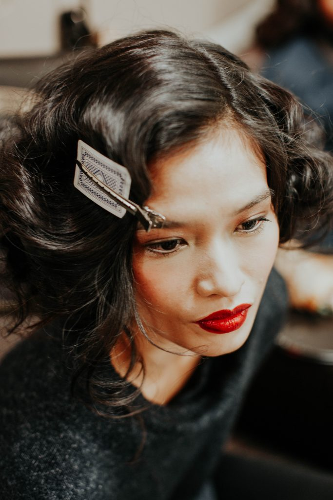 finishing touches hair and makeup backstage NYFW 2017 image